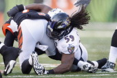 Dannell Ellerbe of the Baltimore Ravens makes the tackle during the game against the Cincinnati Bengals at Paul Brown Stadium on December 30 2012 in...