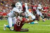 Dannell Ellerbe of the Miami Dolphins breaks up a pass intended for Brian Leonard of the Tampa Bay Buccaneers in the first quarter at Raymond James...