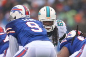 Dannell Ellerbe of the Miami Dolphins has his eyes fixed on Thad Lewis of the Buffalo Bills during NFL game action at Ralph Wilson Stadium on...