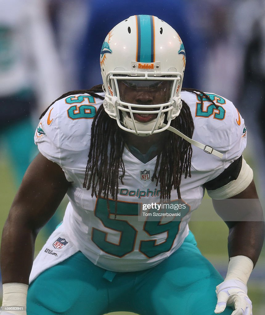 <a gi-track='captionPersonalityLinkClicked' href=/galleries/search?phrase=Dannell+Ellerbe&family=editorial&specificpeople=4090365 ng-click='$event.stopPropagation()'>Dannell Ellerbe</a> #59 of the Miami Dolphins warms up before playing during NFL game action against the Buffalo Bills at Ralph Wilson Stadium on December 22, 2013 in Orchard Park, New York.