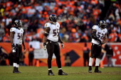 Dannell Ellerbe Terrell Suggs and Ray Lewis of the Baltimore Ravens stand on the field against the Denver Broncos during the AFC Divisional Playoff...