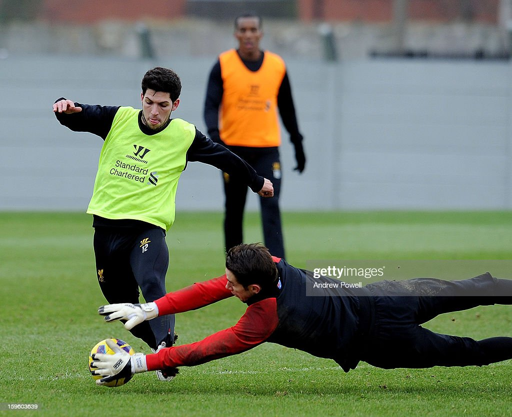 Danni Pacheco and Brad Jones of Liverpool in action during a training session at Melwood Training Ground on January 17, 2013 in Liverpool, England.