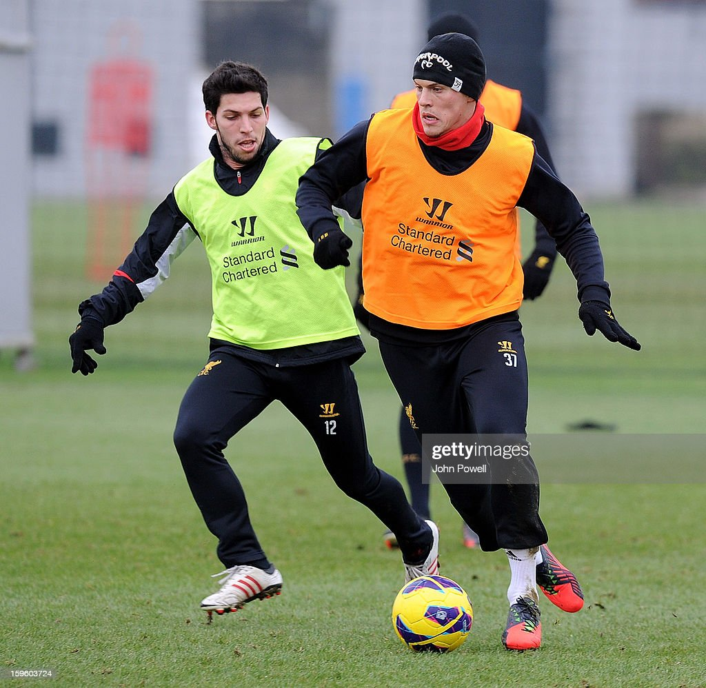 Danni Pacheco and Martin Skrtel of Liverpool in action during a training session at Melwood Training Ground on January 17, 2013 in Liverpool, England.