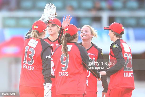 Danni Wyatt of the Renegades celebrates with her teammates after dismissing Amy Satterthwaite of the Hurricanes during the Women's Big Bash League...