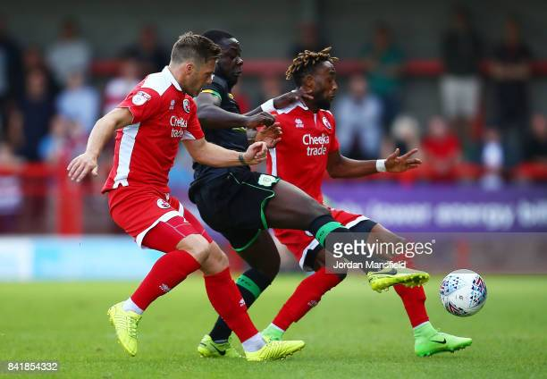 Dannie Bulman and Cedric Evina of Crawley Town tackle with Olufela Olomola of Yeovil Town during the Sky Bet League Two match between Crawley Town...