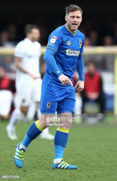 Dannie Bulman of AFC Wimbledon in action during the Sky Bet League One match between AFC Wimbledon and Northampton Town at The Cherry Red Records...