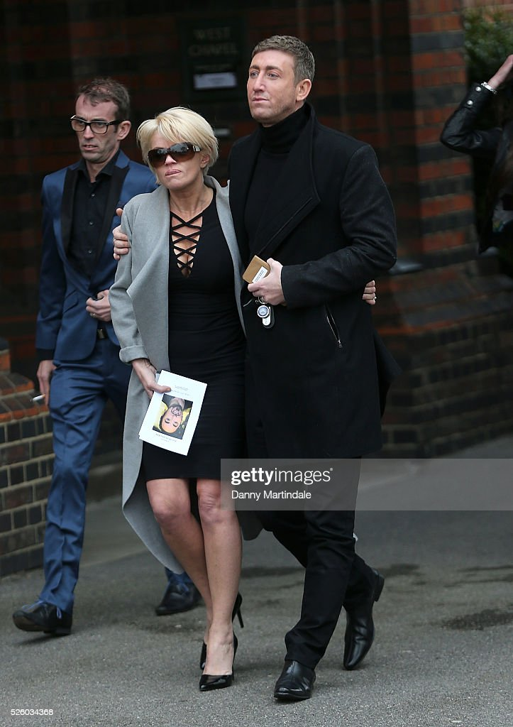 Danniella Westbrook is comforted by Christopher Maloney at the funeral of entertainer producer and reality television star David Gest at Golders...