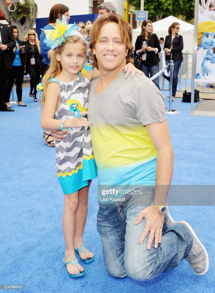 Dannielynn Birkhead and dad Larry Birkhead arrive at the Los Angeles Premiere 'Smurfs 2' at Regency Village Theatre on July 28, 2013 in Westwood, California.