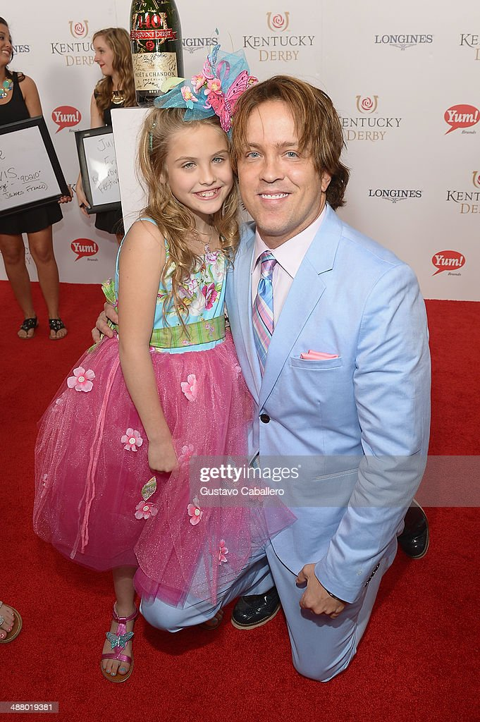 Dannielynn Birkhead (L) and <a gi-track='captionPersonalityLinkClicked' href=/galleries/search?phrase=Larry+Birkhead&family=editorial&specificpeople=4145280 ng-click='$event.stopPropagation()'>Larry Birkhead</a> toasts with Moet & Chandon at the 140th Kentucky Derby at Churchill Downs on May 3, 2014 in Louisville, Kentucky.