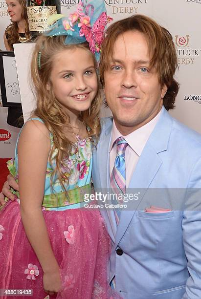 Dannielynn Birkhead and Larry Birkhead toasts with Moet Chandon at the 140th Kentucky Derby at Churchill Downs on May 3 2014 in Louisville Kentucky