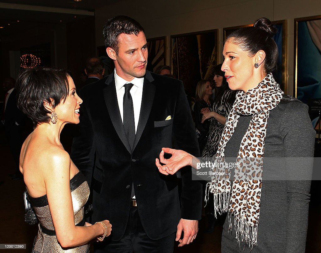 Dannii Minogue (L) and Kris Smith (C) talk with Giaan Rooney as they arrive at the annual Million Dollar Lunch fundraiser for children with cancer on July 29, 2011 in Melbourne, Australia.