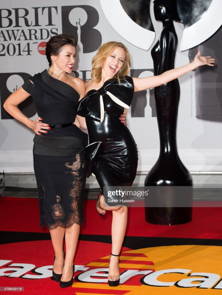 Dannii Minogue and Kylie Minogue (R) attends The BRIT Awards 2014 at 02 Arena on February 19, 2014 in London, England.