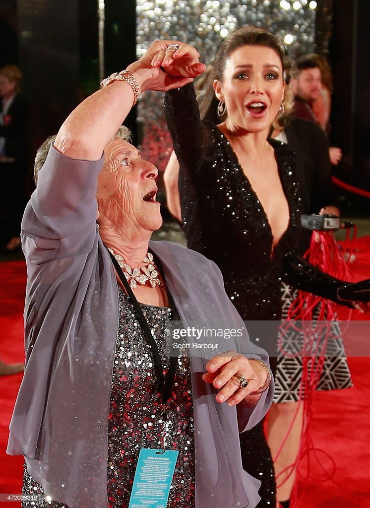 Dannii Minogue dances with Nonna Paola as she arrives at the 57th Annual Logie Awards at Crown Palladium on May 3, 2015 in Melbourne, Australia. Italian mother Nonna Paola became an internet hit after her son filmed her attempting to use Siri, an Apple application.