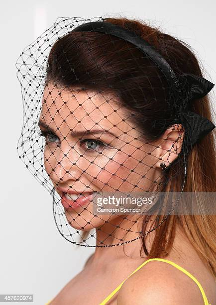Dannii Minogue poses at the Hat Valet service announcement at Virgin Lounge Sydney Domestic Airport on October 22 2014 in Sydney Australia