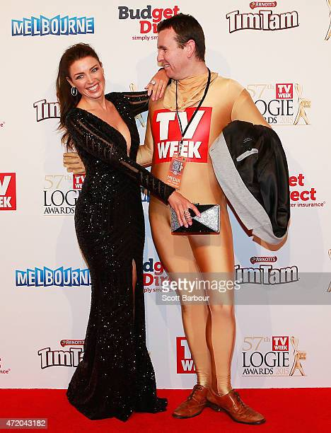 Dannii Minogue poses for a photo with Intern Pete from the Kyle and Jackie O show in a Morphsuit as she arrives at the 57th Annual Logie Awards at...