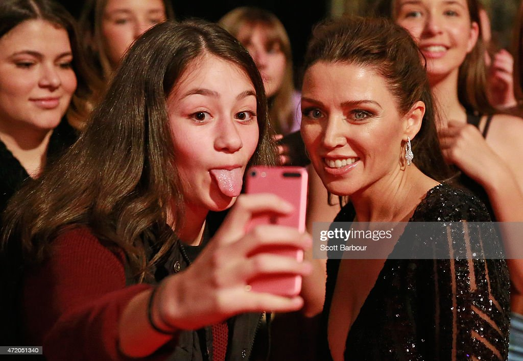Dannii Minogue poses for a selfie with a fan in the crowd who sticks her tongue out at the 57th Annual Logie Awards at Crown Palladium on May 3, 2015 in Melbourne, Australia.