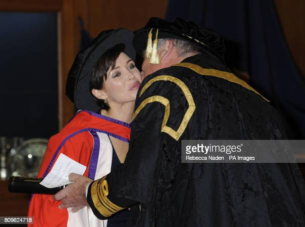 Dannii Minogue receives her Doctor of Media honorary degree from Southampton Solent University from Admiral the Lord West of Spithead Chancellor of...