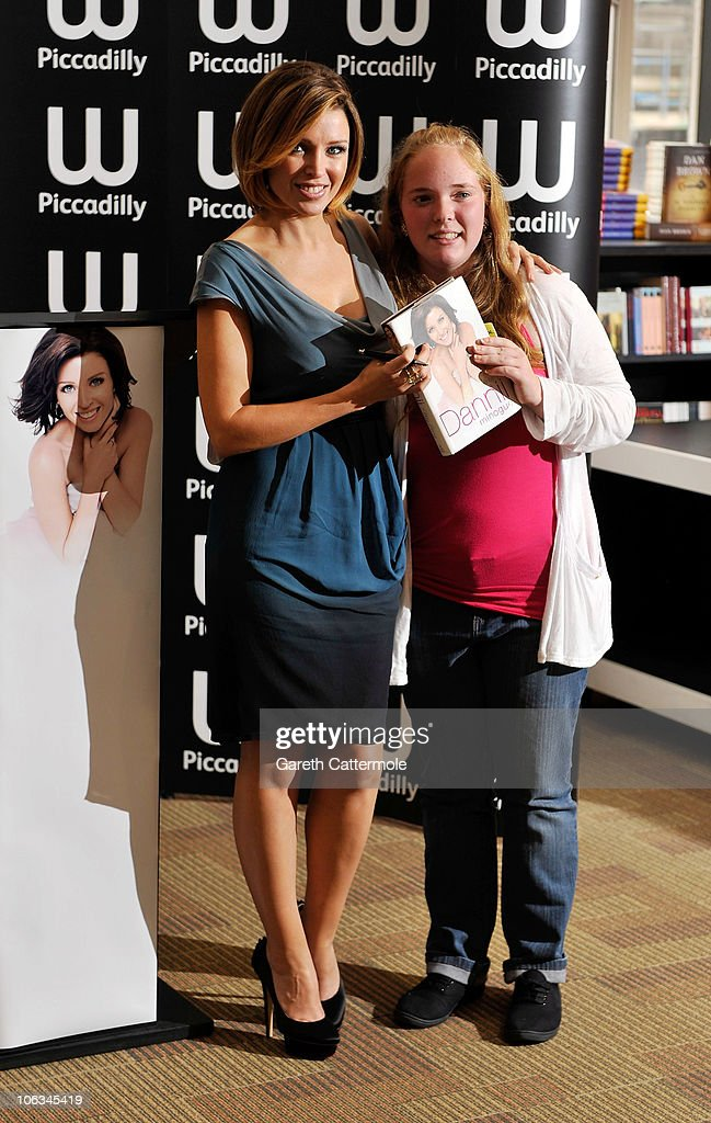 Dannii Minogue (L) signs copies of her new book ' 'Dannii My Story' at Waterstones Piccadilly on October 29, 2010 in London, England.