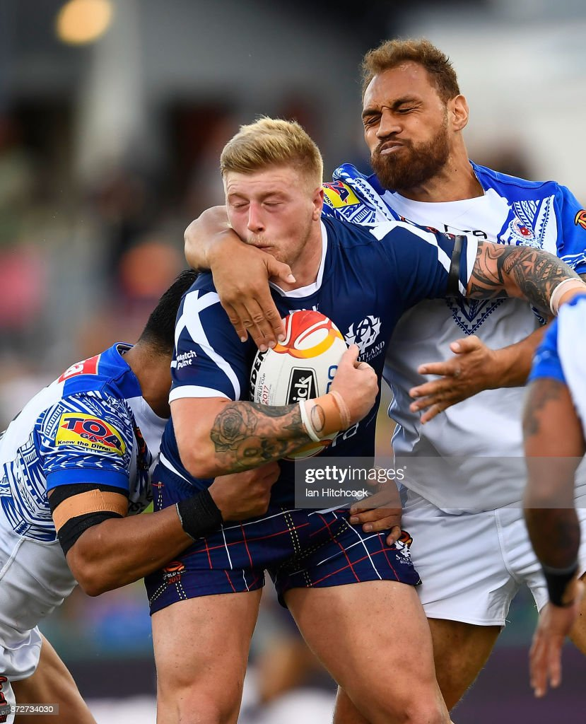 Danny Addy of Scotland is tackled during the 2017 Rugby League World Cup match between Samoa and Scotland at Barlow Park on November 11, 2017 in Cairns, Australia.
