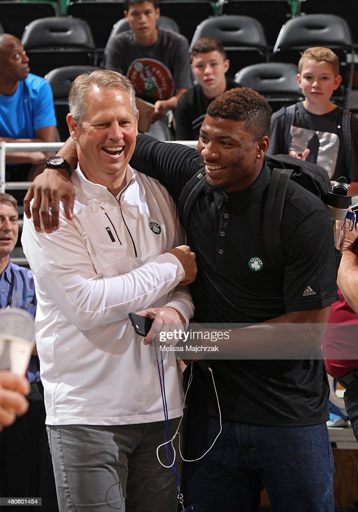 Danny Ainge and Marcus Thornton #36 of the Boston Celtics share a laugh before a game against the Philadelphia 76ers at EnergySolutions Arena on July 07, 2015 in Salt Lake City, Utah.