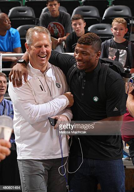Danny Ainge and Marcus Thornton of the Boston Celtics share a laugh before a game against the Philadelphia 76ers at EnergySolutions Arena on July 07...