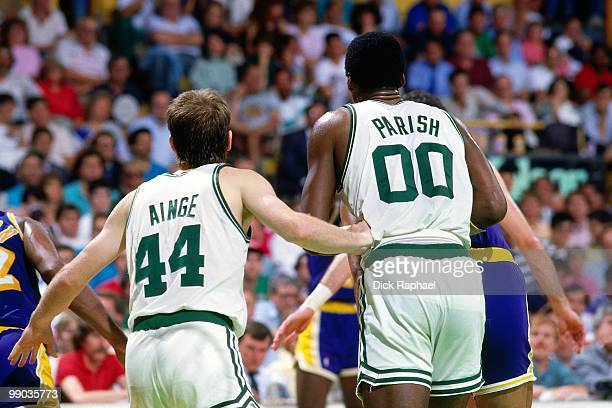 Danny Ainge and Robert Parish of the Boston Celtics defend against the Los Angeles Lakers during the 1987 NBA Finals at the Boston Garden in Boston...