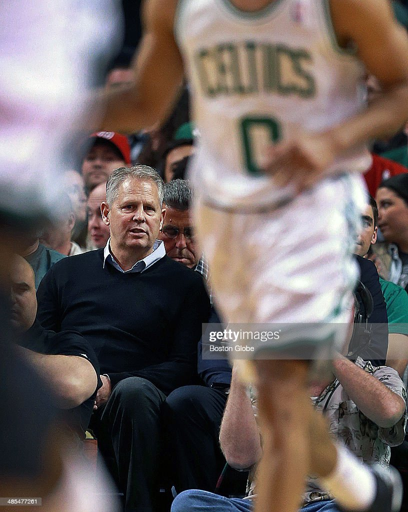 Danny Ainge, Celtics president and general manager, watches the action from his seat along the baseline. The Boston Celtics hosted the Washington Wizards in their final NBA game of the season at the TD Garden on Wednesday, April 16, 2014.