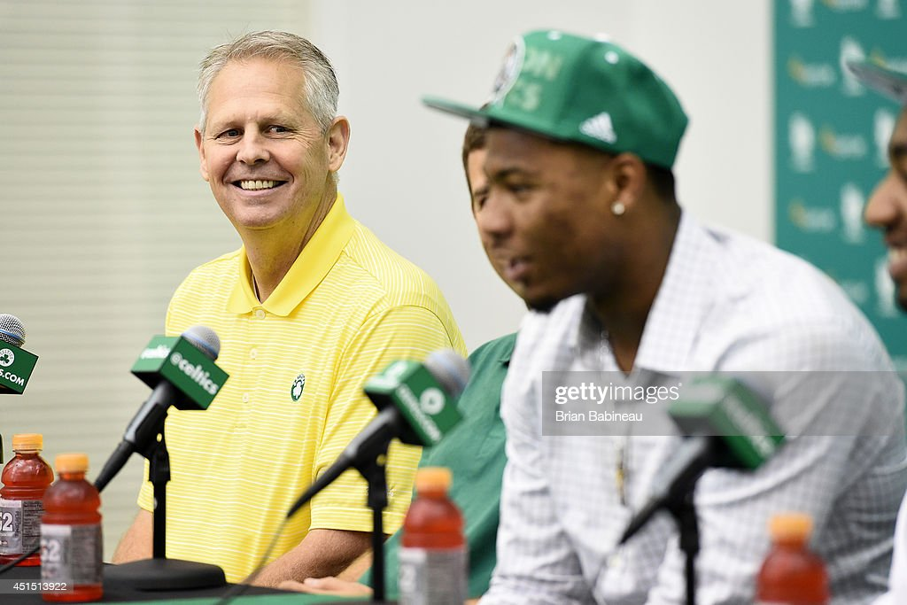 Danny Ainge listens to Marcus Smart speak to the media during a press conference on June 30, 2014 at the Boston Celtics Training Center in Waltham, Massachusetts .