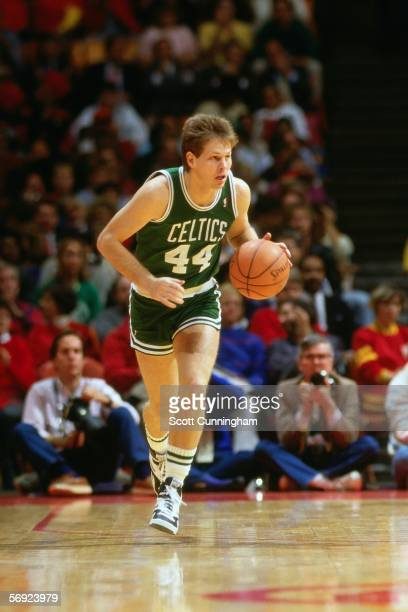 Danny Ainge of the Boston Celtics dribbles the ball upcourt against the Atlanta Hawks during an NBA game at the Omni circa 1986 in Atlanta Georgia...