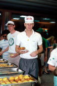Danny Ainge of the Boston Celtics enjoys a meal after winning against the Houston Rockets circa 1986 at the Boston Garden in Boston Massachusetts...