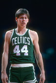 Danny Ainge of the Boston Celtics looks on while there's a break in the action against the Washington Bullets during an NBA basketball game circa...