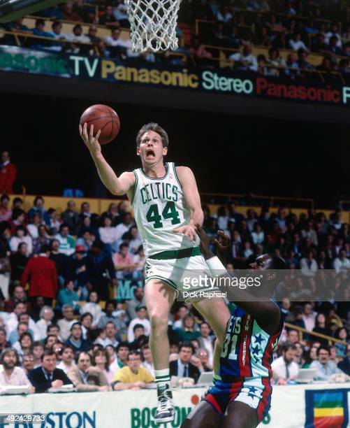 Danny Ainge of the Boston Celtics shoots against the New Jersey Nets during a game played in 1988 at the Boston Garden in Boston Massachusetts NOTE...