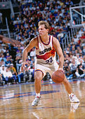 Danny Ainge of the Phoenix Suns dribbles circa 1993 at the America West Arena in Phoenix Arizona NOTE TO USER User expressly acknowledges and agrees...
