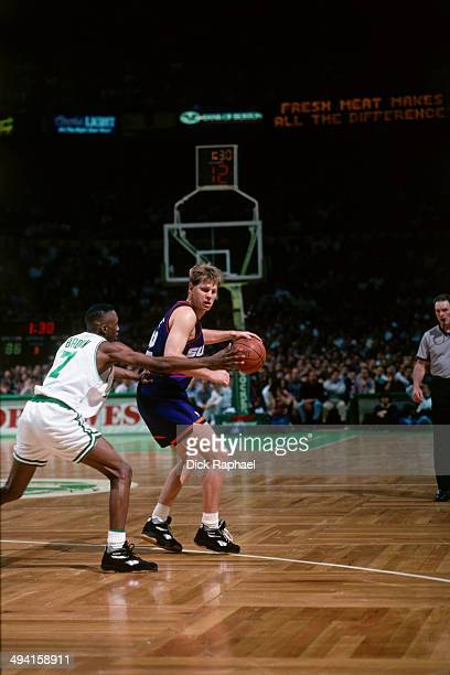 Danny Ainge of the Phoenix Suns handles the ball against Dee Brown of the Boston Celtics during a game played at the Boston Garden in Boston...