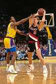 Danny Ainge of the Portland Trail Blazers passes the ball against the Los Angeles Lakers circa 1991 at the Great Western Forum in Inglewood...
