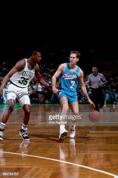 Danny Ainge of the Sacramento Kings drives against Reggie Lewis of the Boston Celtics during a game played circa 1990 at the Boston Garden in Boston...
