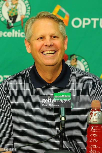 Danny Ainge speaks at a press conference announcing Keith Bogans MarShon Brooks and Kris Humphries as a members of the Boston Celtics on July 15 2013...
