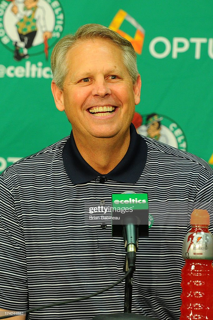 Danny Ainge speaks at press conference announcing Keith Bogans, MarShon Brooks and Kris Humphries as a members of the Boston Celtics on July 15, 2013 at The Training Center at Healthpoint in Waltham, Massachusetts.