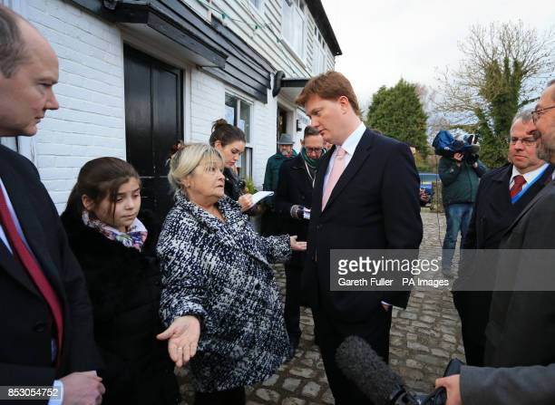 Danny Alexander Chief Secretary to the Treasury talks to Celia Gudgeon during a visit to Yalding Kent which was badly hit by flooding earlier this...