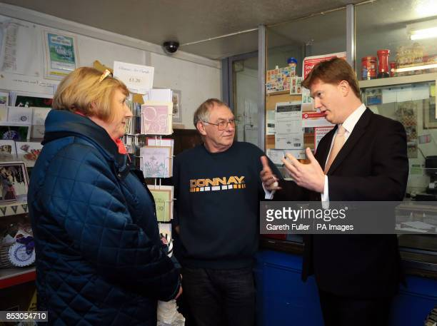 Danny Alexander Chief Secretary to the Treasury talks to Geraldine Brown Chairman of the Parish Council and Postmaster Tim Chapman during a visit to...