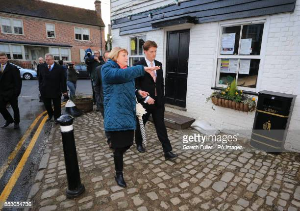 Danny Alexander Chief Secretary to the Treasury talks to Geraldine Brown Chairman of the Parish Council during a visit to Yalding Kent which was...