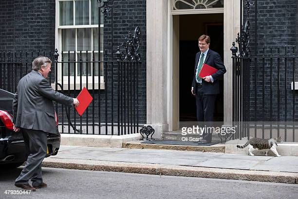 Danny Alexander the Chief Secretary to the Treasury and Ken Clarke admire Larry the Downing Street cat as they arrive to attend a weekly cabinet...