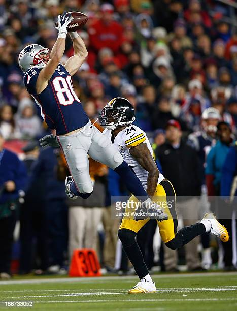 Danny Amendola of the New England Patriots catches a pass in front of Ike Taylor of the Pittsburgh Steelers in the second half at Gillette Stadium on...