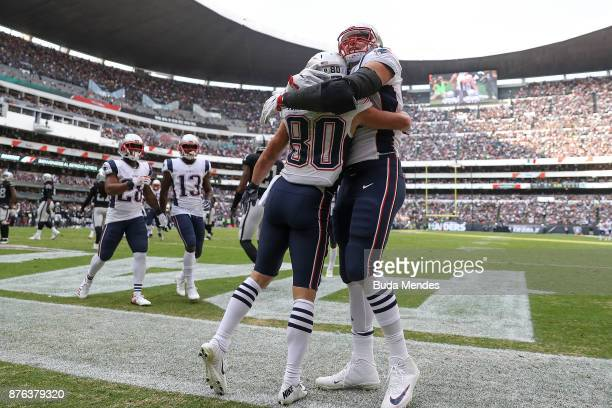 Danny Amendola of the New England Patriots celebrates with Rob Gronkowski after a touchdown against the Oakland Raiders during the first half at...