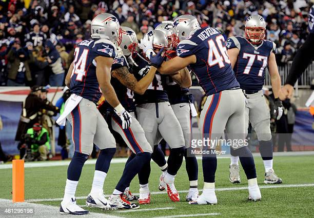 Danny Amendola of the New England Patriots celebrates with teammates after scoring a third quarter touchdown against the Baltimore Ravens during the...