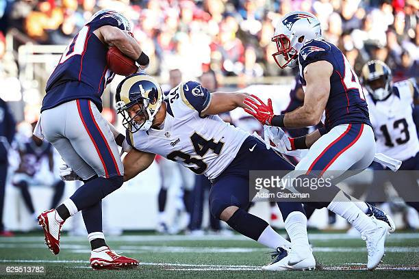 Danny Amendola of the New England Patriots is tackled by Chase Reynolds of the Los Angeles Rams during the game at Gillette Stadium on December 4...