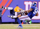 Danny Amendola of the New England Patriots is tackled by Jonathan Casillas of the New York Giants in the final minutes of the game at MetLife Stadium...