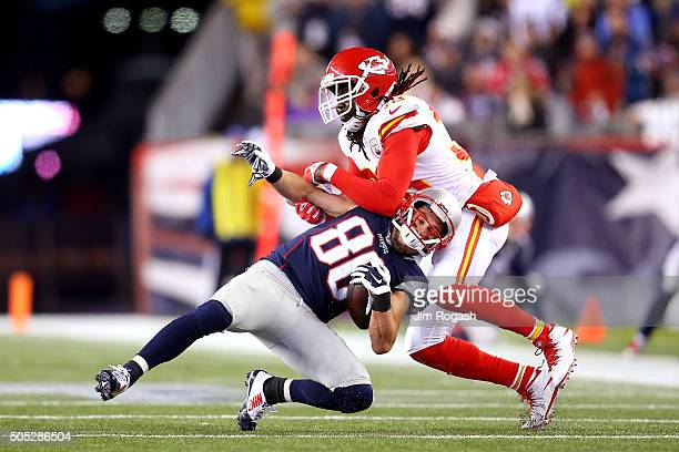 Danny Amendola of the New England Patriots is tackled by Ron Parker of the Kansas City Chiefs in the first half during the AFC Divisional Playoff...