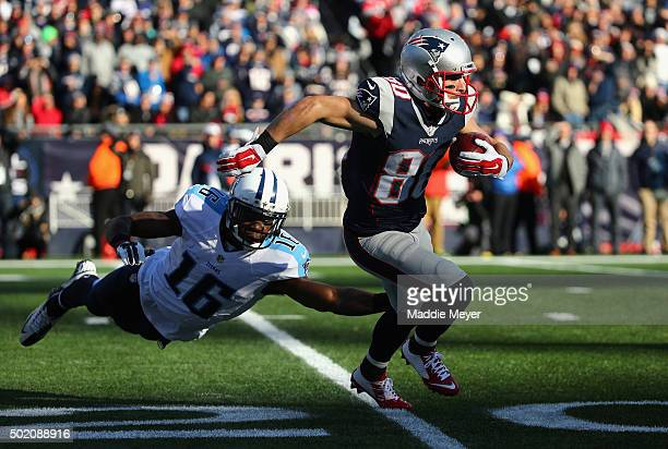 Danny Amendola of the New England Patriots returns a punt as Tre McBride of the Tennessee Titans attempts to tackle him during the first half at...