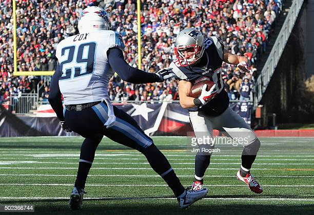 Danny Amendola of the New England Patriots runs with the ball as Perrish Cox of the Tennessee Titans defends him during their game at Gillette...